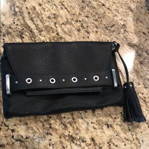 Black clutch with detachable strap.